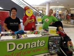 2013 happy volunteers at shopping centre stall